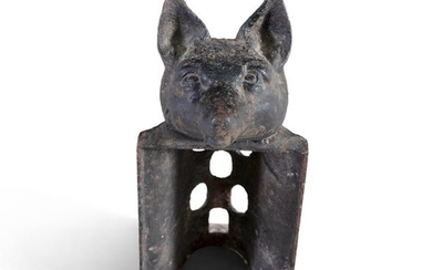A VICTORIAN CAST IRON SADDLE RACK, with fox head t…
