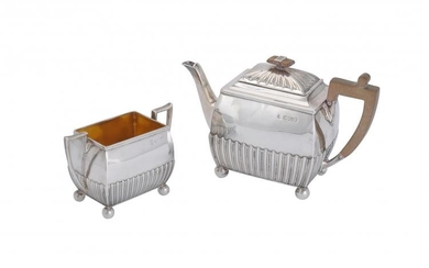 A Victorian silver swollen rectangular tea pot and sugar basin by Horace Woodward & Co.