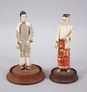 TWO 19TH CENTURY BURMESE POLYCHROME FIGURES on circular