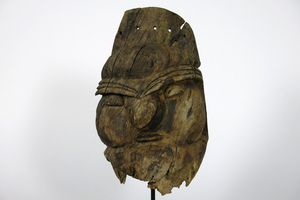 """probably """"Kanak"""" human face mask in eroded wood..."""