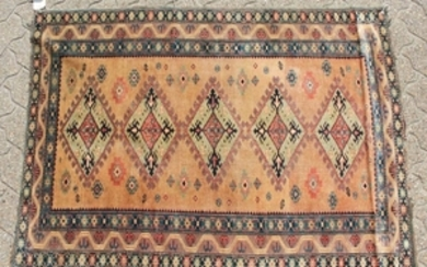 AN ARMENIAN RUG with five diamond shaped motifs and