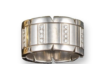 A white gold and diamond tank track ring by Cartie…