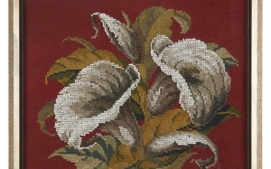 A framed needlepoint and beadwork depicting calla lilies 20th...