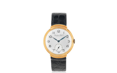 International Watch Company. An 18K gold manual wind wristwatch with hooded lugs
