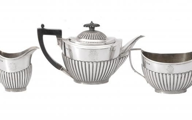 A late Victorian silver oval tea service by The Goldsmiths & Silversmiths Co. Ltd
