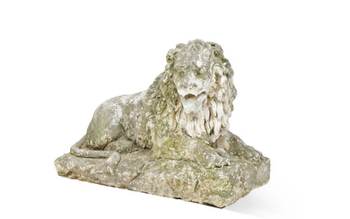 A large composition stone figure of a recumbent lion