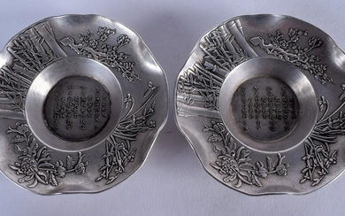 A PAIR OF CHINESE SILVERED BRONZE DISHES. 10 cm wide.