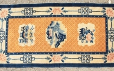 A CHINESE WOOL RUG with three main motifs with blue and