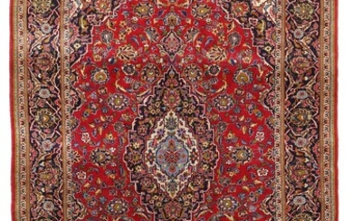 A Persian Keshan rug, classic medallion design on red base. 20th century. 211×136 cm.