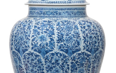 A massive blue and white jar and cover
