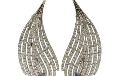 A pair of tanzanite and diamond ear pendants each set with an oval-cut tanzanite and numerous brilliant-cut diamonds, mounted in 18k white gold. L. 5.3 cm. (2)