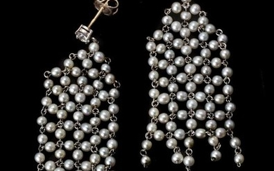 A pair of diamond, pearl and emerald ear pendants