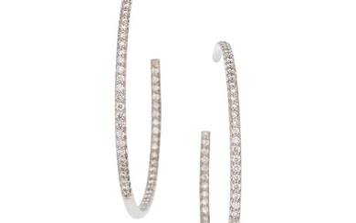 Diamond, White Gold Earrings The inside-out hoop earrings featuring...