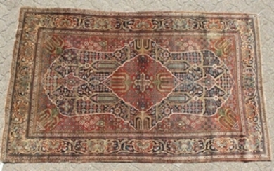 A PERSIAN KASHAN KORK WOOL RUG with a large central