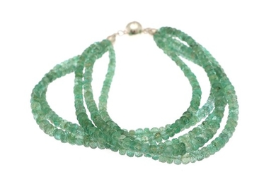 A five string emerald bracelet set with numerous roundel-cut emeralds and magnet clasp of sterling silver. L. 19 cm.
