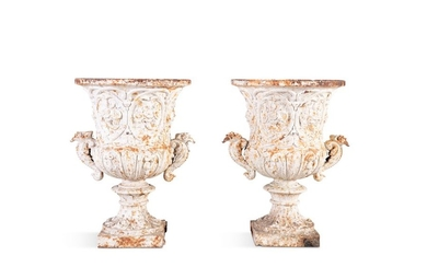 A PAIR OF 19TH CENTURY CAST IRON URNS, of campagna…