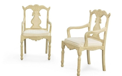 A pair of Anglo-Indian painted hardwood armchairs