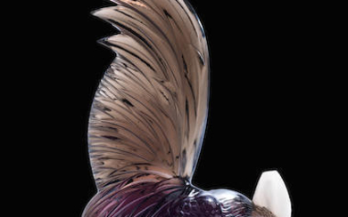 A 'Coq Nain' mascot in topaz coloured glass with scarlet core by Rene Lalique, French, introduced 10th February 1928,