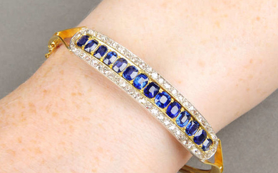 A late Victorian 15ct gold sapphire and diamond hinged bangle.