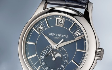 Patek Philippe, Ref. 5205 A highly rare and attractive limited edition white gold instantaneous annual calendar wristwatch with blue dial, certificate of origin, portfolio and fitted presentation box