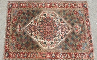 AN OLD BAKHTIARI PERSIAN RUG 1920'S-1930'S, with a