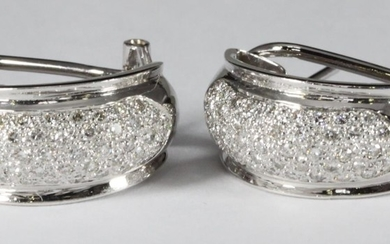 A pair of 18ct white gold half hoop earrings pave set with r...