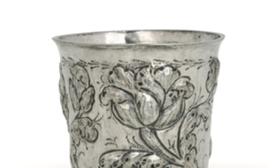 A glass in embossed and chiselled silver with floral motives. Germany? 16th-17th century, apparently ...