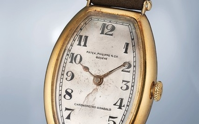 Patek Philippe, An extremely rare yellow gold tonneau shaped wristwatch with box
