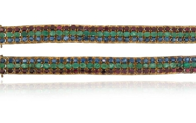 A pair of gem-set gold bracelets, each set...