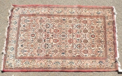 A LARGE PERSIAN KASHAN RUG with allover design on a
