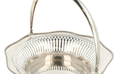 Puffs / bread basket with handle finished with rolled up pearl edges and openwork silver bars.