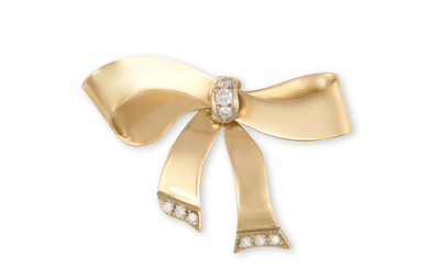 A GOLD AND DIAMOND BROOCH...