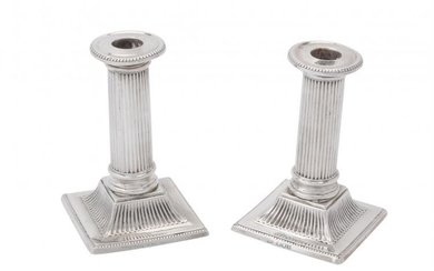 A pair of late Victorian silver small square candlesticks by Charles Stuart Harris