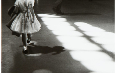Louis Stettner (1922-2016), Young Girl Playing in Light Circles, Penn Station, New York City (1958)