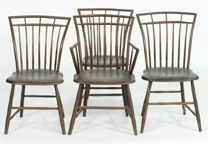 SET OF FOUR CHICKEN COOP PLANK-SEAT WINDSOR CHAIRS Includes three side chairs and one armchair, all under reddish brown paint. Back...