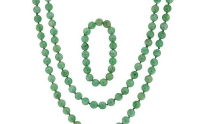 A jade bead necklace and bracelet, the green...