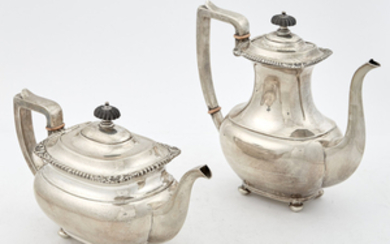 Meriden Brittania Co. Sterling Silver and Ebonized Wood Five-Piece Footed Coffee and Tea Service