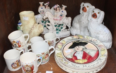 SECTION 43. A pair of Staffordshire pottery seated Spaniels...