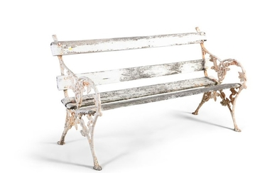 A VICTORIAN WHITE PAINTED CAST IRON GARDEN BENCH, …