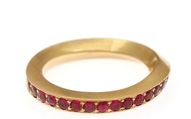 A ruby ring set with numerous circular-cut rubies, mounted in 18k gold. Size 58.