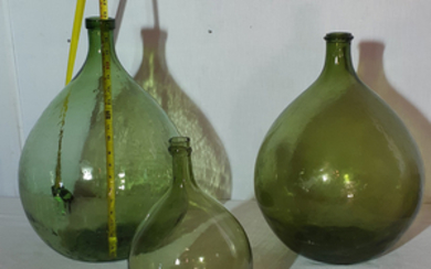 GROUP OF 4 GLASS BULBOUS FORMED DEMIJOHNS