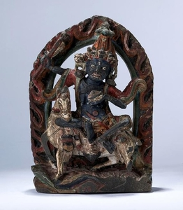 TIBET A PAINTED CARVED STONE FIGURE OF LHAMO