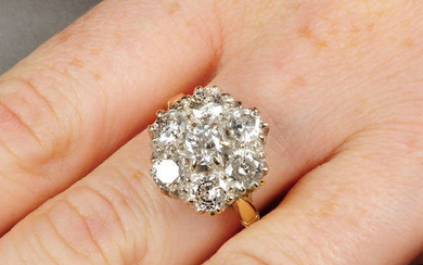 An 18ct gold brilliant-cut diamond cluster ring.