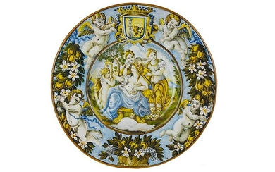 Plate Wide brimmed plate with wide cavetto. Recto: majolica painted...