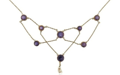 An Edwardian amethyst and seed pearl necklace, suspending...