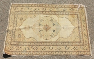 A PERSIAN TABRIZ HAJ-JALILI RUG with large central