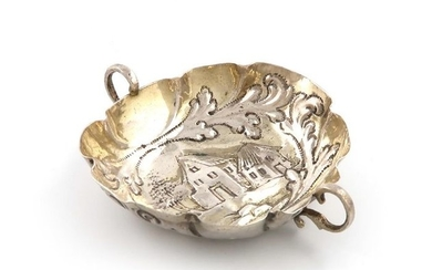 A late 17th century German parcel gilt silver two …