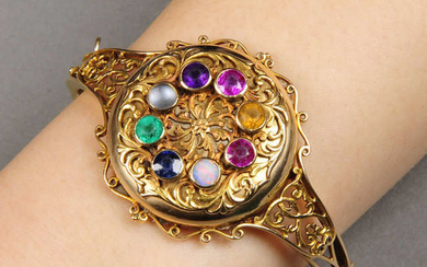 An Edwardian 15ct gold locket bangle, with gem acrostic