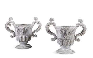 A PAIR OF 19TH CENTURY CAST LEAD URNS, the bodies …