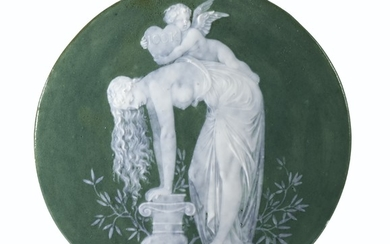 A FRENCH PORCELAIN PATE-SUR-PATE OLIVE-GREEN GROUND CIRCULAR PLAQUE BY LOUIS SOLON, DATED 1869, POSSIBLY SEVRES, SIGNED AND DATED MILES 69 (THE PSEUDONYM FOR LOUIS SOLON)